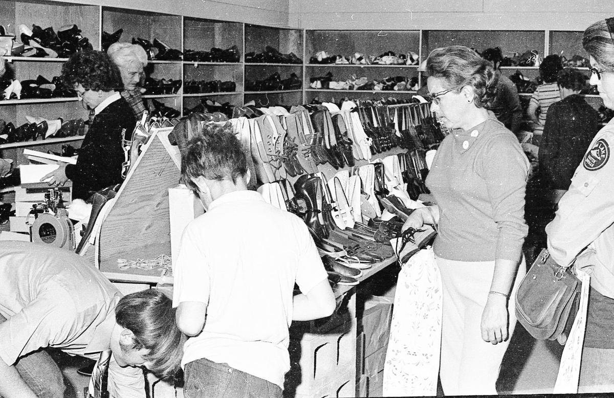 Golden Rule fire sale 1970; in back, left, Florence Anthony who worked there, and Grace Gant