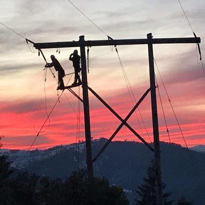 Pacific Power crew restore power
