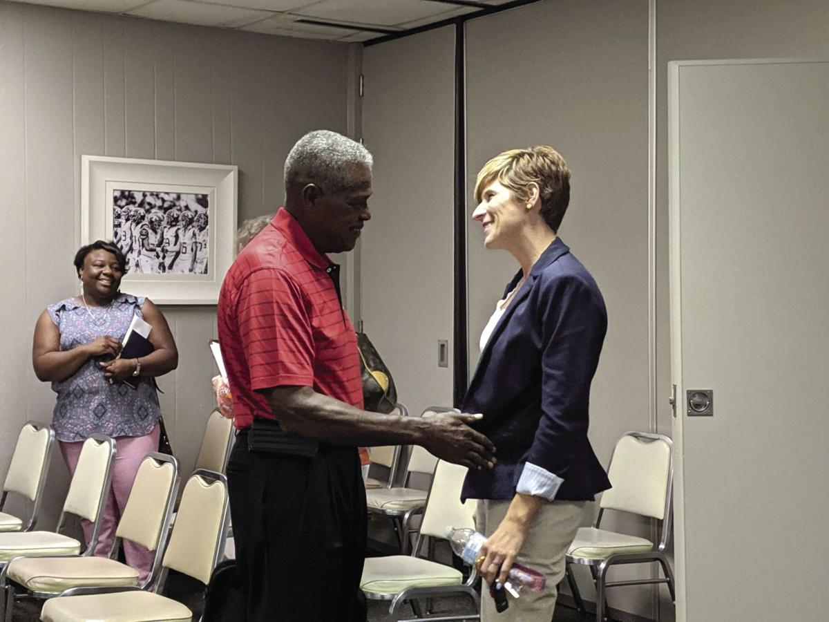 TCBOE board member John Smith congratulates new Len Lastinger Principal Patsy Shivers after her appointment on July 9.