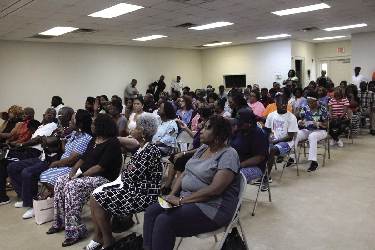 The meeting for a possible recycling center on Martin Luther King Jr. Drive was crowded with concerned citizens.