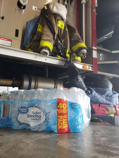 Firefighters go through cases of water while working and wearing their gear. The drive helps replenish their stockpile.