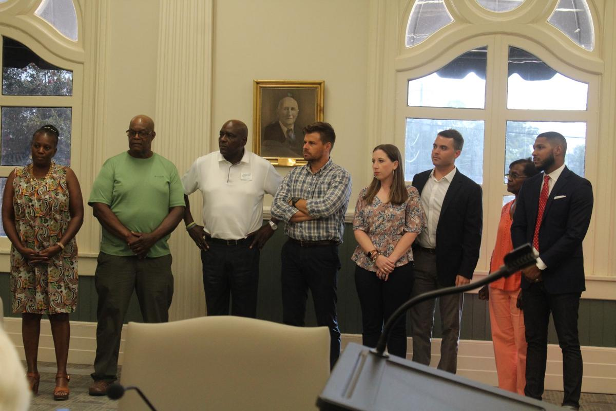 Seven Urban Redevelopment Authority board members and an alternate were sworn in at the July 15 Tifton city council meeting.