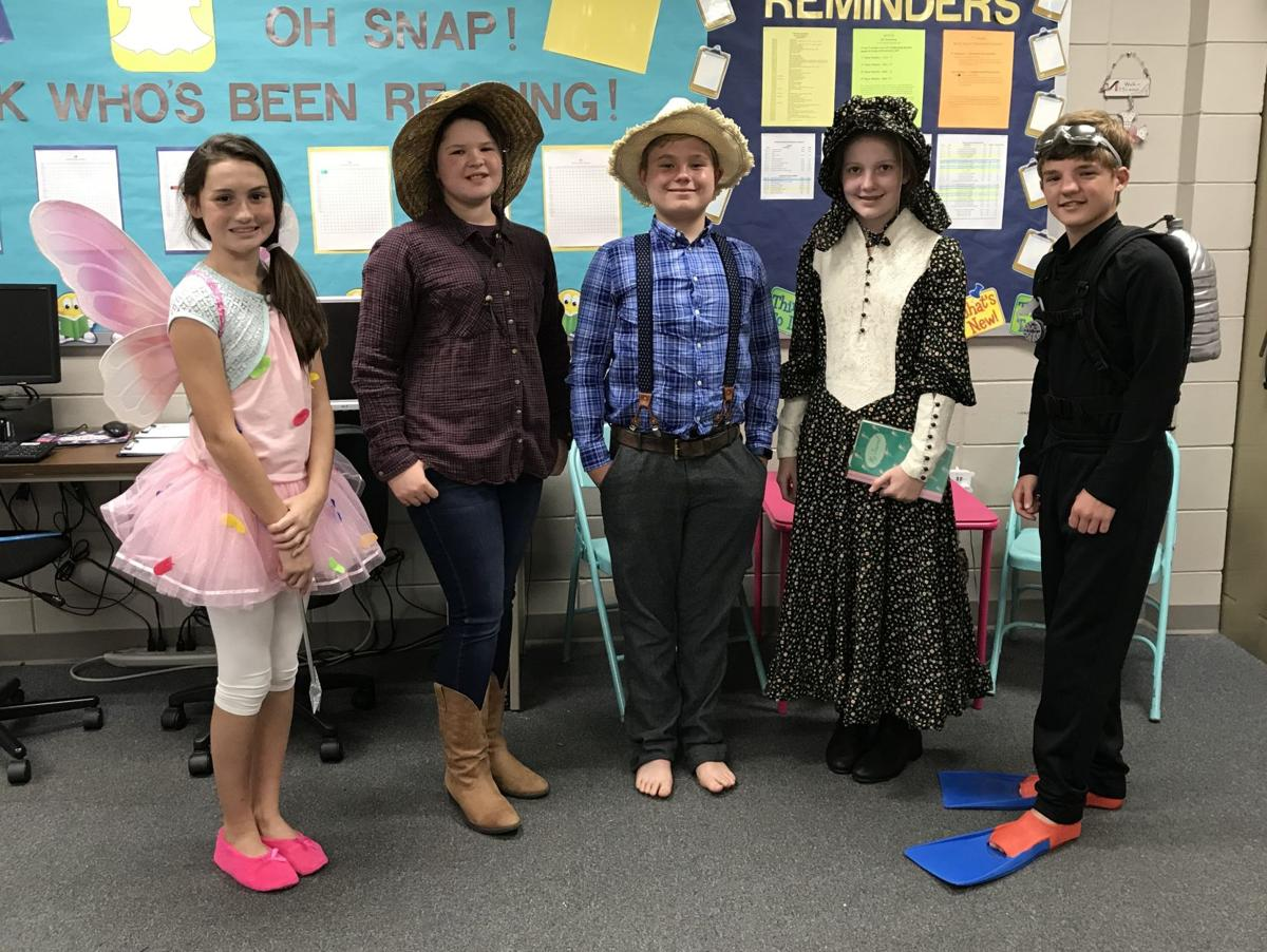 Some of the Tiftarea students dressed up as characters from the books they read for oral book reports.