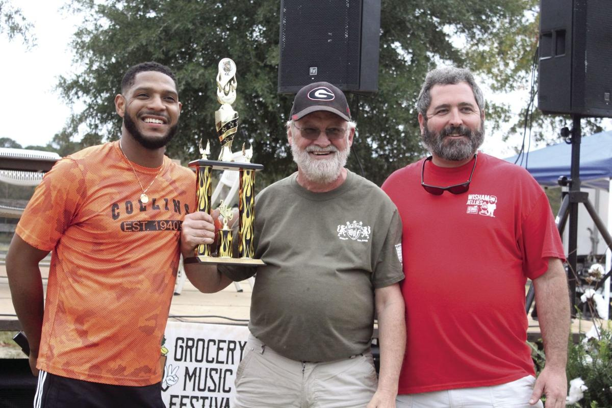 Lonnie Lewis with Fabulous Yard Birds cook team took home the first place trophy for the wing cookoff.