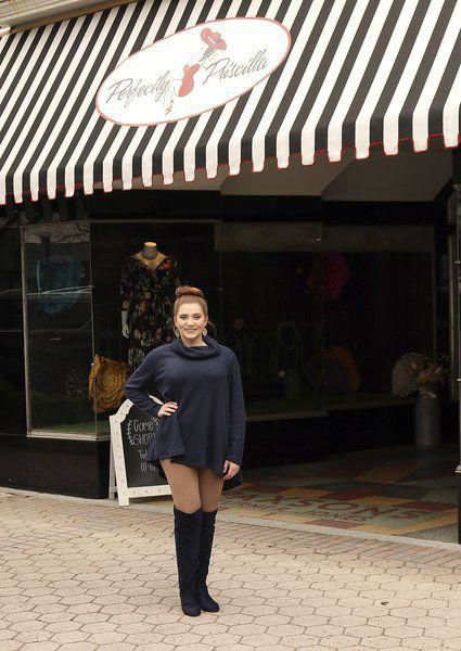 Store manager Kately Sellars stands outside the recently opened Perfectly Priscilla Boutique.