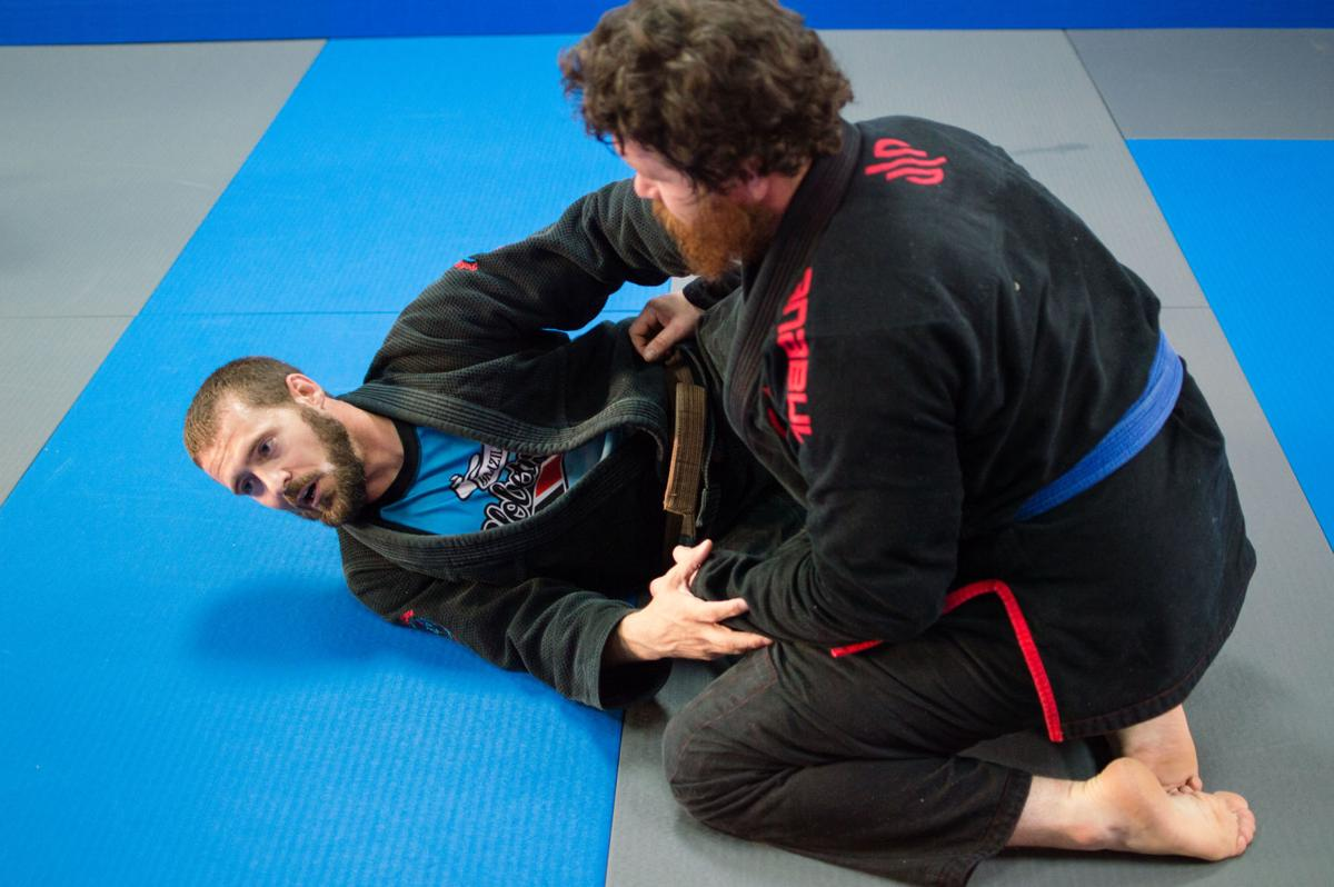 Joshua Clements and Jesse Snow demonstrating a sweep.