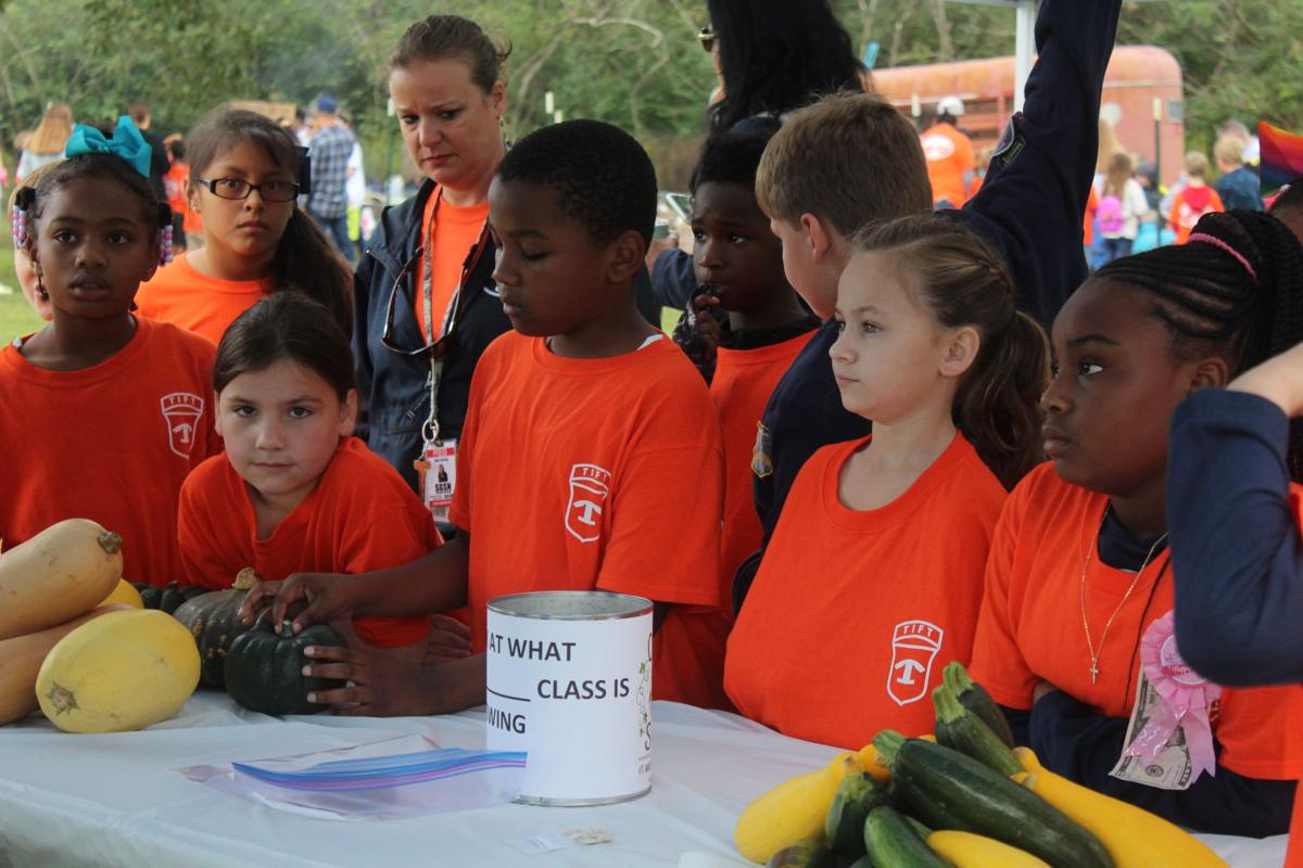 Third graders learned about vegetables at Farm Day.