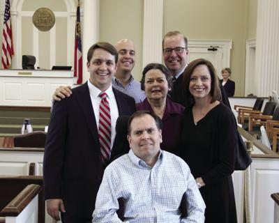 Brian Griffin with his family after being sworn in by Judge Bill Reinhardt. Back row: Billy Griffin and Judge Bill Reinhardt. Middle row: Brian Griffin, Betty Griffin and Tammy Griffin. Front row: Dr. Charles Griffin.
