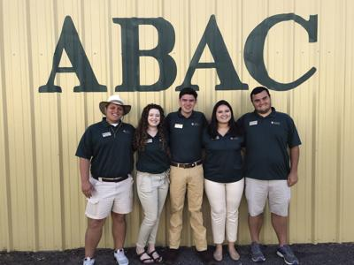 ABAC Ambassadors Landon Rowe, Hannah King, Will Bostleman, Emily Ralston, and Johnathon Strickland welcome visitors to the ABAC building at the Sunbelt Agricultural Exposition.
