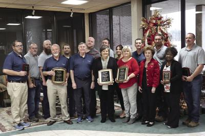 Pictured are the employees who were awarded with plaques of gratitude for their years of dedicated service. Front row: Jerry Huggins (40 years), Danny Sterling, Janice McBrayer (30 years) Carol Lee (45 years), Beverly Sterling, Alisha Taylor (10 years).  Back row:  Walt Wyndroski (10 years), Tim Thacker (10 years), Colt Swords (10 years), Clay Carpenter (10 years), Chad Purvis (10 years), Brad Brownlee (5 years), Celeste McNeil (5 years), David Nelson (15 years), Kyle Gaskins (15 years) and Dana Diers (10 years).  Not pictured Jackie Miles (10 years).