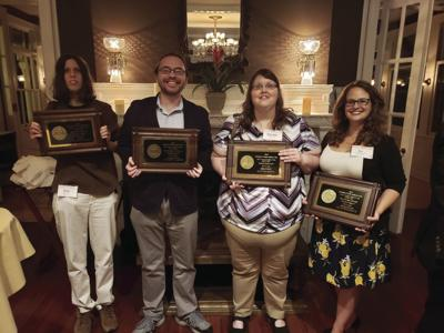 Sports editor Becky Taylor, editor Stuart Taylor, layout paginator Mary Beth Yeary and reporter Eve Copeland-Brechbiel accepting awards at the Georgia Press Association banquet May 31.