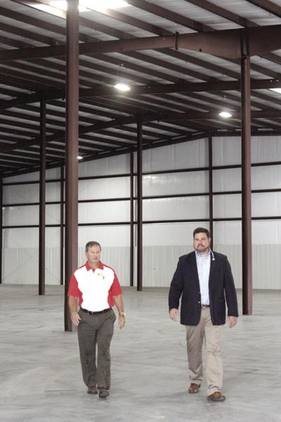 Tifton Tift County Chamber of Commerce chairman Darian Peavy tours the new facility with Second Harvest CEO and director Frank Richards.