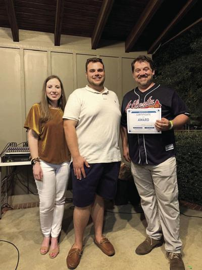 Abbey McLaren, Downtown Development Authority director; judge Randy Chambers and winner Josh Morrison at the finale on Sept. 26.