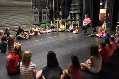 Children in the summer camp program at Tift Theatre begin each rehearsal circling up for vocal and body warm-ups.