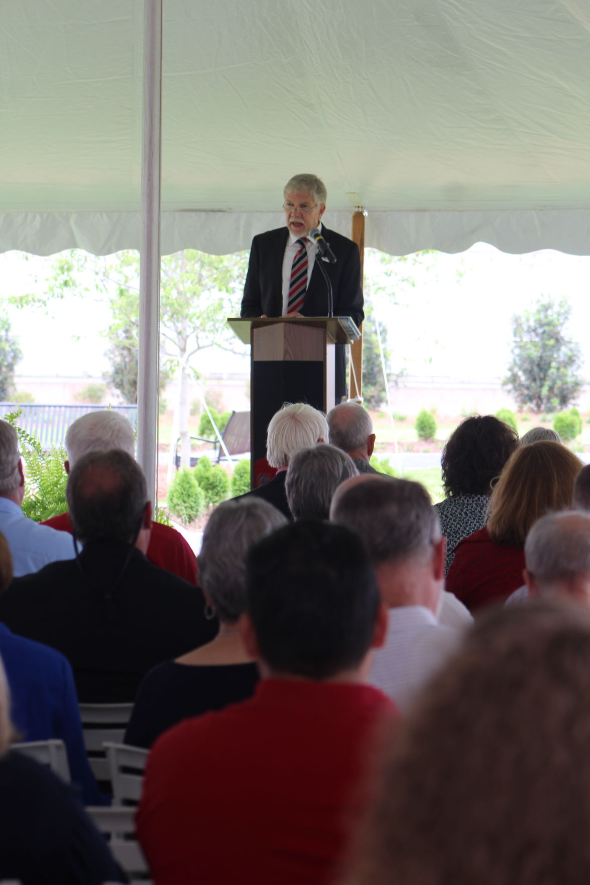 West speaks at the garden ribbon cutting ceremony, which was part of the centennial celebration for the campus.