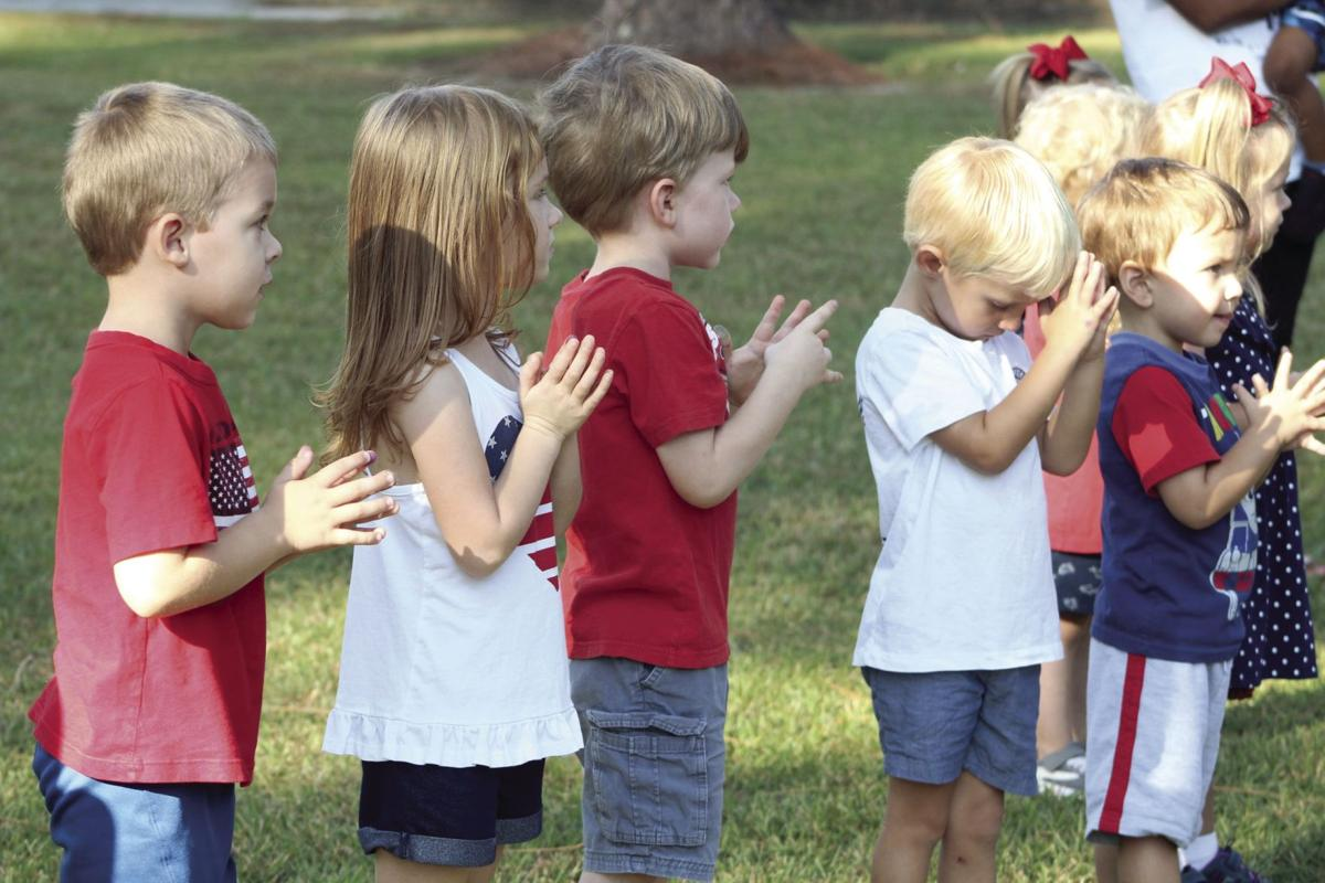 Three year olds from Potter's House Childcare and Learning Center took time out of their day to honor Patriot Day on the 18th anniversary of the 9/11 terrorist attacks.