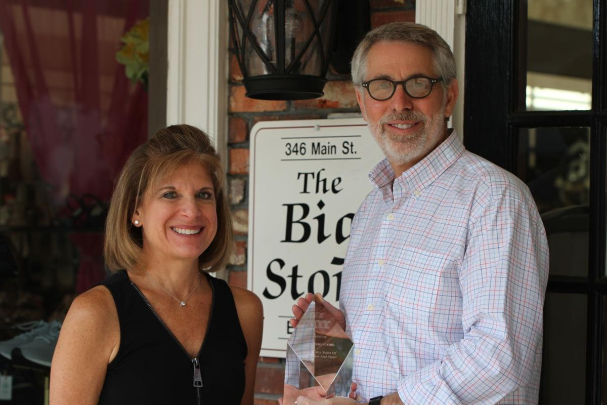 "Susan and Phil Perlis with their award from ""MR magazine"" for being in business for over 100 years."