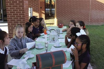 Annie Belle Clark students pretend to be the Daughters of Liberty and meet to make their own tea and read letters they wrote.