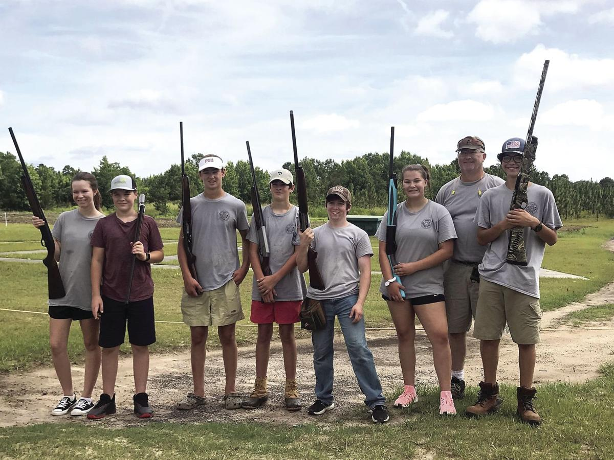 Tift Shotgun team members (left to right): Skylar Brevard, Maddox Brevard, Logan Parrish, Charlie Bryan, Jace Maraman, Celiabeth Branch, Coach Bennie Branch, and Cader Lawrence.