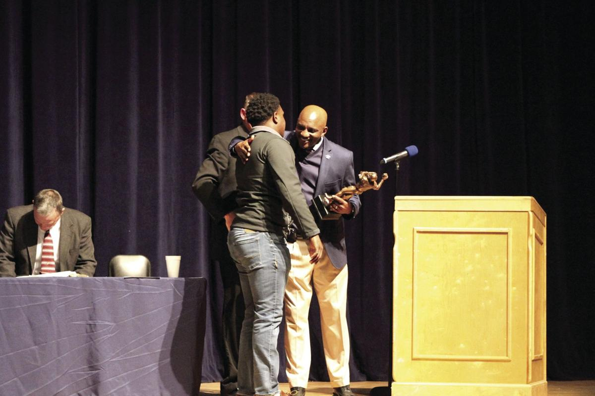 Anthony Bateman (right) presents the Gene Brodie Award to Landon Bateman at the TIft County football banquet in January.