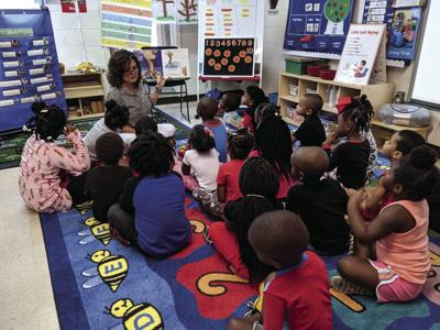 "Mayor Julie Smith read ""Llama Llama Red Pajama"" to pajama-clad preschoolers at Maggie Campbell's Gingerbread House to kick off Georgia's ninth annual Pre-K Week."