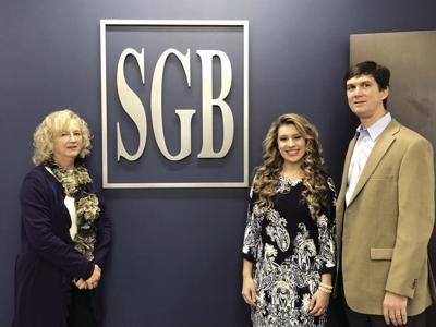 Southwest Georgia Bank market president Chad Carpenter (right) and vice president Joy Ledford (left) present the Southwest Georgia Bank scholarship to ABAC student Katelyn Watson from Ashburn.