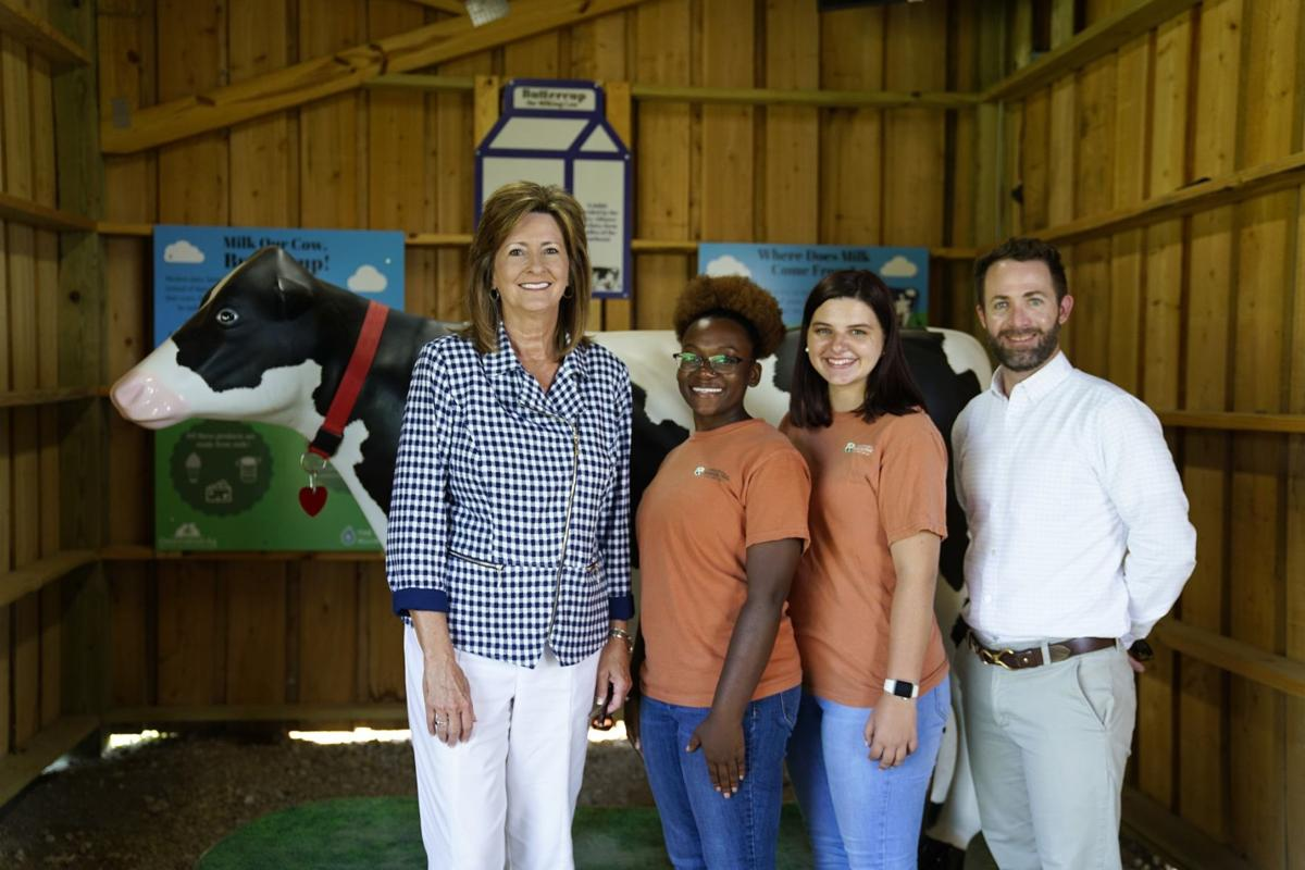 The Georgia Power Foundation, Inc., recently made a donation to the Destination Ag program at ABAC's Georgia Museum of Agriculture and Historic Village. On hand for the presentation were (l-r): Georgia Power Area Manager Lynn Lovett, ABAC students Deaunna Holsey and McKenzie Lewis, and Museum Director Garrett Boone.
