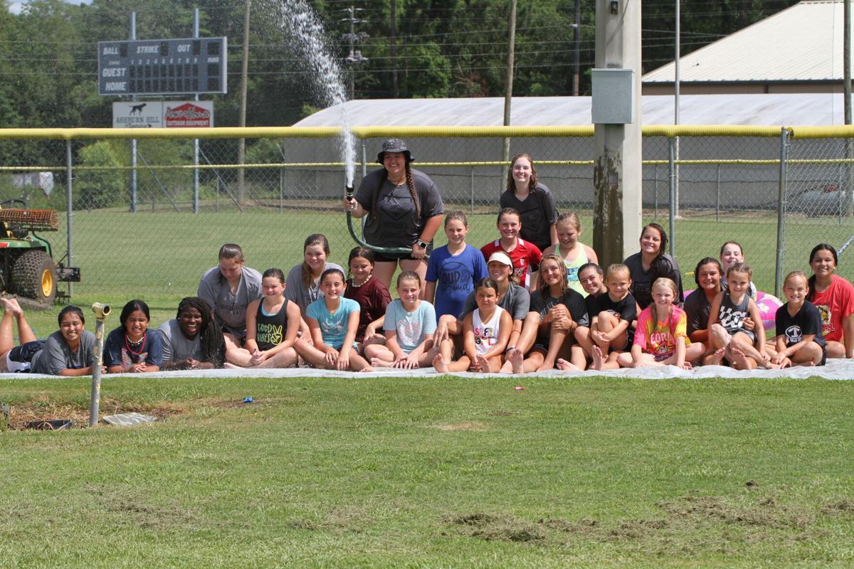 Practice run: Slip and slide part of drills at softball camp