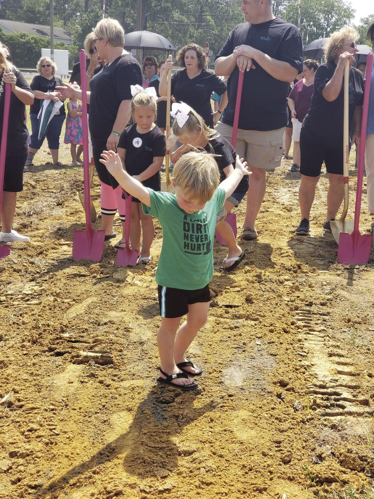 Ward's nephew, Landon Ward, helped with the dirt throwing at the groundbreaking.
