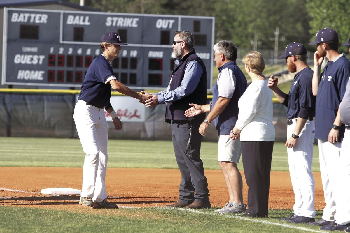 Senior baseball player Trey Barfield (left) shakes hands with TIft Superintendent Adam Hathaway prior to a game in April.