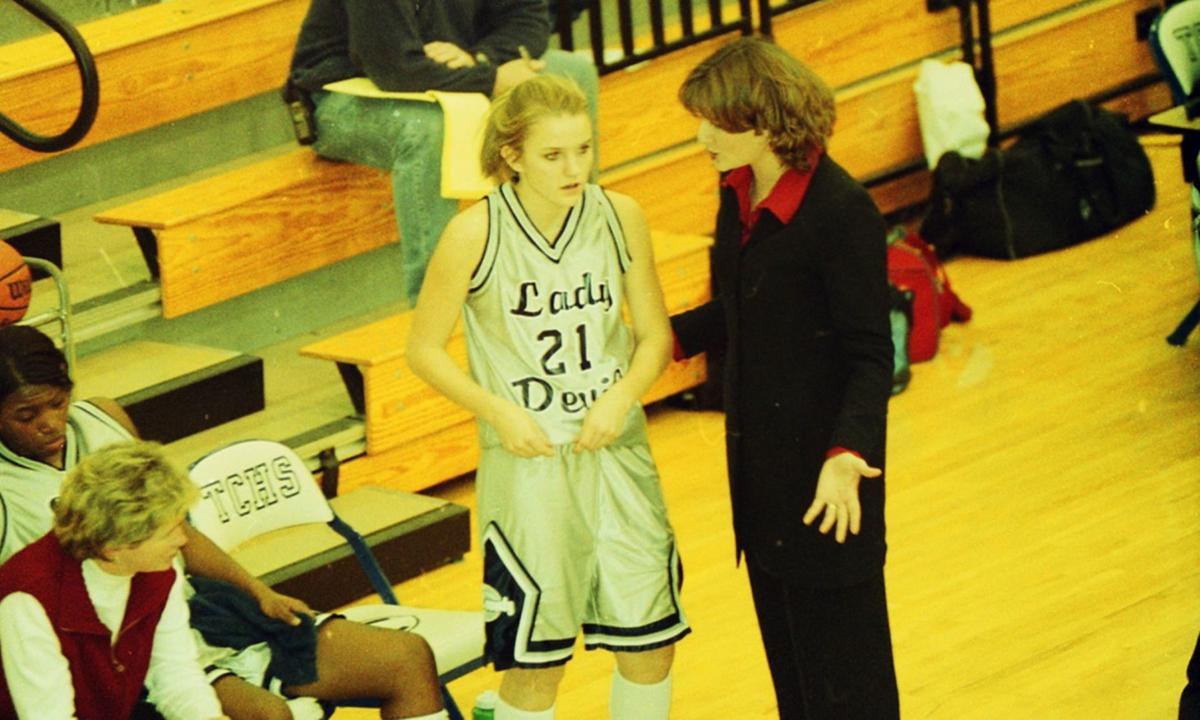 Ivey Vickers (left) assists the Lady Devils on the basketball court in 2002-03. The team was head coached by Michelle Caldwell (right), who is speaking to Shelley Baxter.
