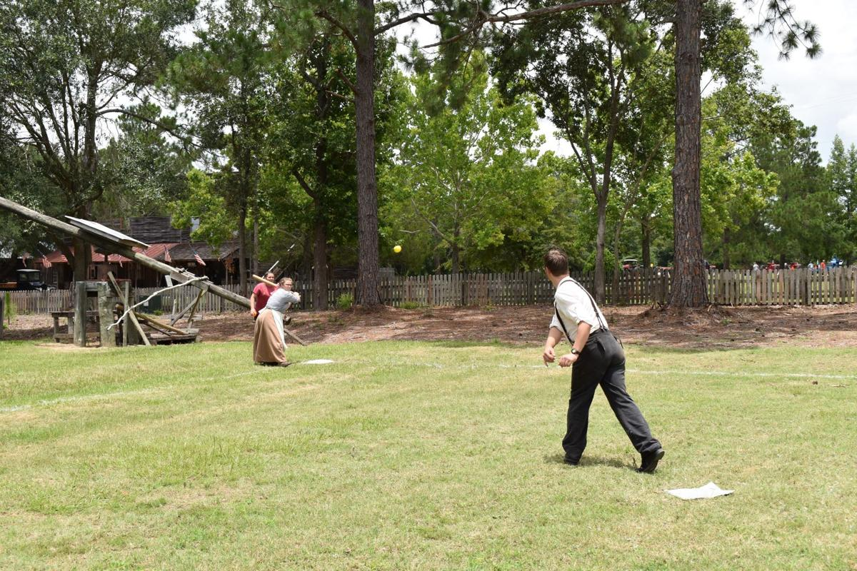Historic interpreters at the GMA play an old-fashioned game of baseball for onlookers.