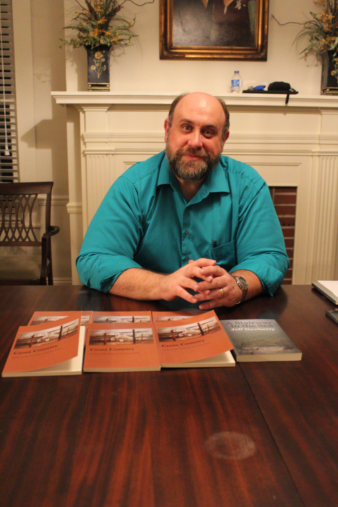 """Local author and ABAC professor, Jeff Newberry releases his most recently published book, """"Cross Country,"""" coauthored with Justin Evans."""