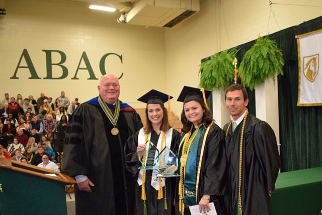 ABAC president David Bridges (left) and ABAC Alumni Association president Dan Hobby (right) presented the 2019 fall commencement awards to two Tifton students, Kaycee Aultman (middle right) and Kaycee Goodman (middle left)..jpg