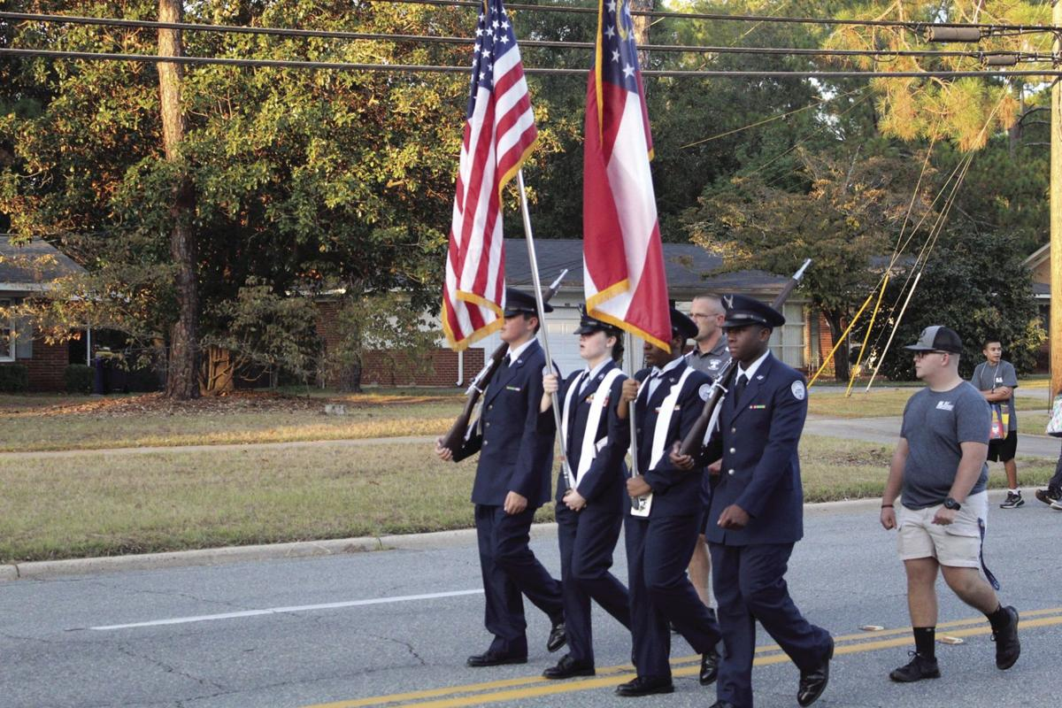 The Air Force JROTC from TCHS starts the parade off with a presentation of the colors.