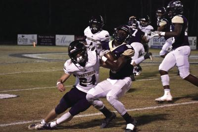 Tiftarea's Will Ross (24) makes one of his many tackles on the night against John Milledge's Kelvin Jackson (9).