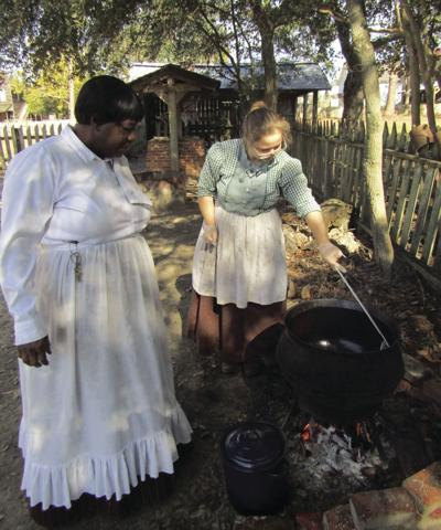 Interpreters from ABAC's Georgia Museum of Agriculture cook on an open hearth.
