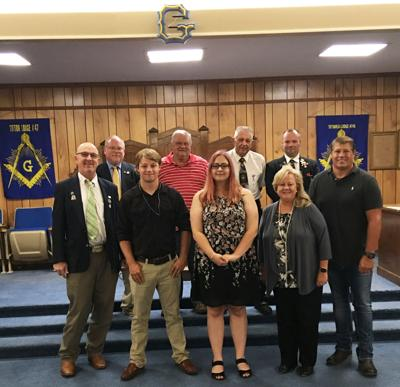 On hand for the Masonic Lodge of Tifton #47 and #745 F&AM Endowed Scholarship presentation to ABAC were front row (l-r): Dave Powell, Cole Talley, Marlee Talley, Dr. Deidre Martin and Lee Talley (father of scholarship recipients); back row (l-r): Howard Maddox, Robert Kicklighter, Bert Connell, and Jeremy Hobbs.