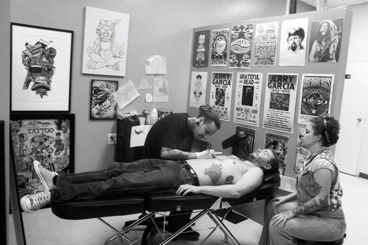 Chase Nolan tattooing a client