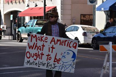 Panhandle Slim holds MLK sign
