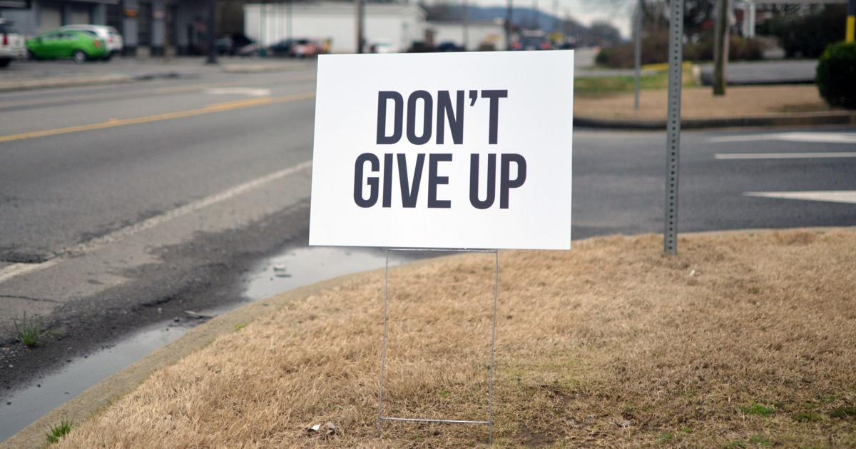 Uplifting signs offer encouragement and hope