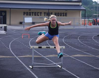 Wallace hurdles past school record