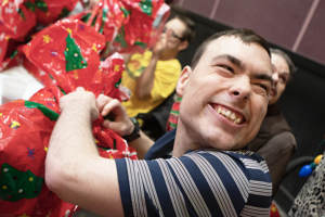 """<p class=""""p1""""><span class=""""s1"""">Pictured is Ben G. opening his Christmas gifts at the ARC Christmas Party.</span></p>"""