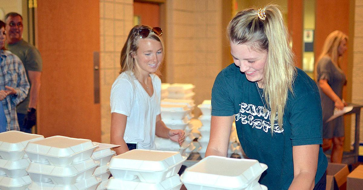 Neighboring churches unite to feed people in need