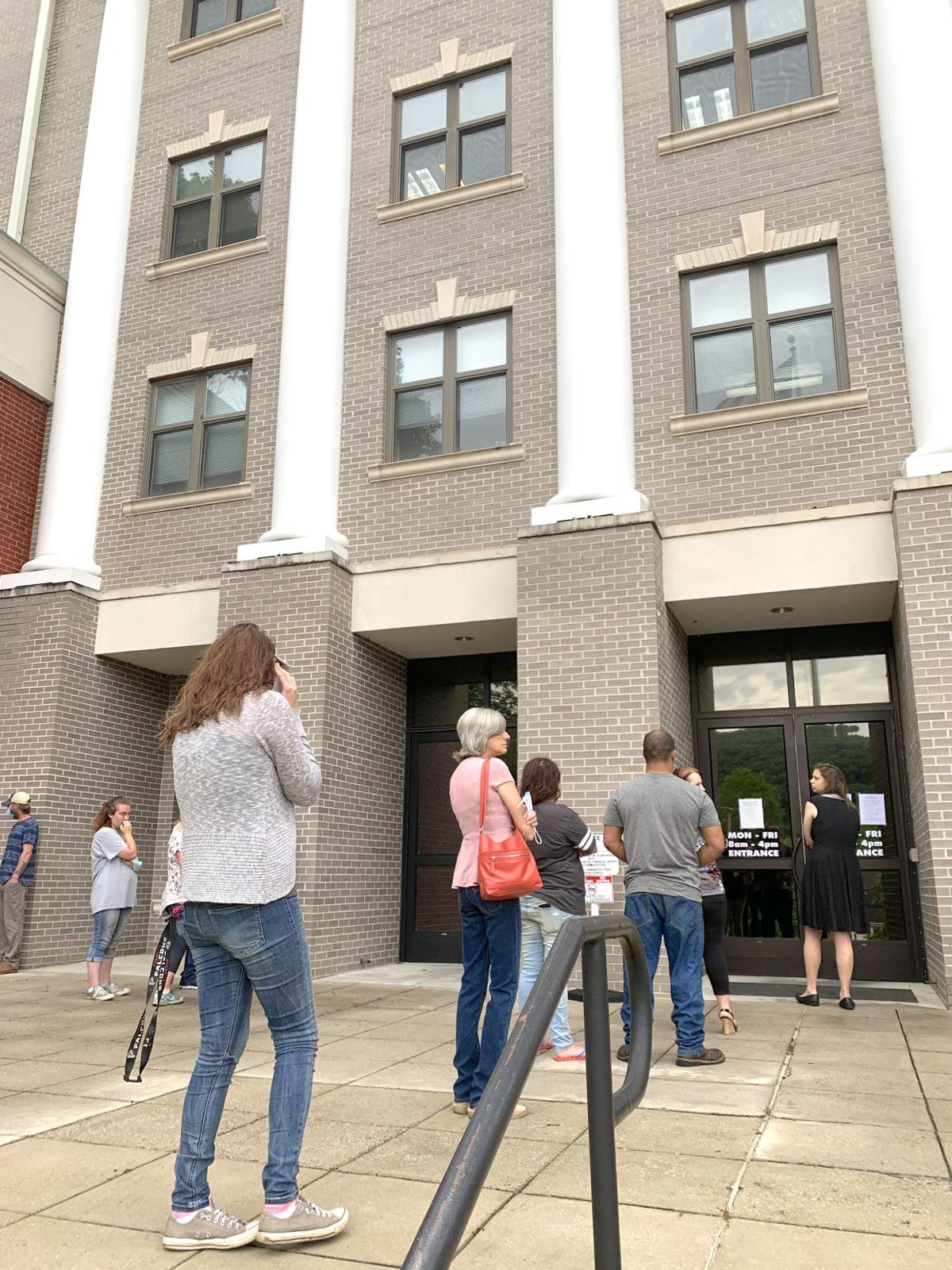 Long lines at courthouse as it reopens to public