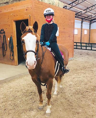 Nine-year-old girl learning lifelong skills