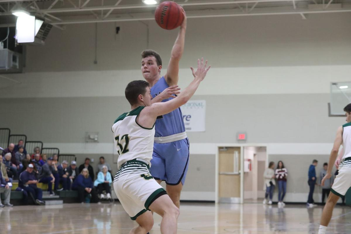 Late free throws lift Bears past Rams
