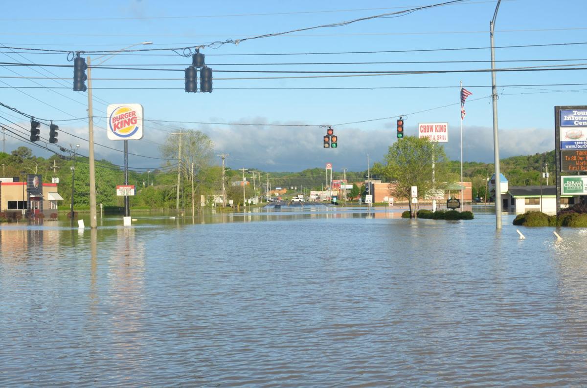 Flood waters damage DeKalb bridges, homes and businesses