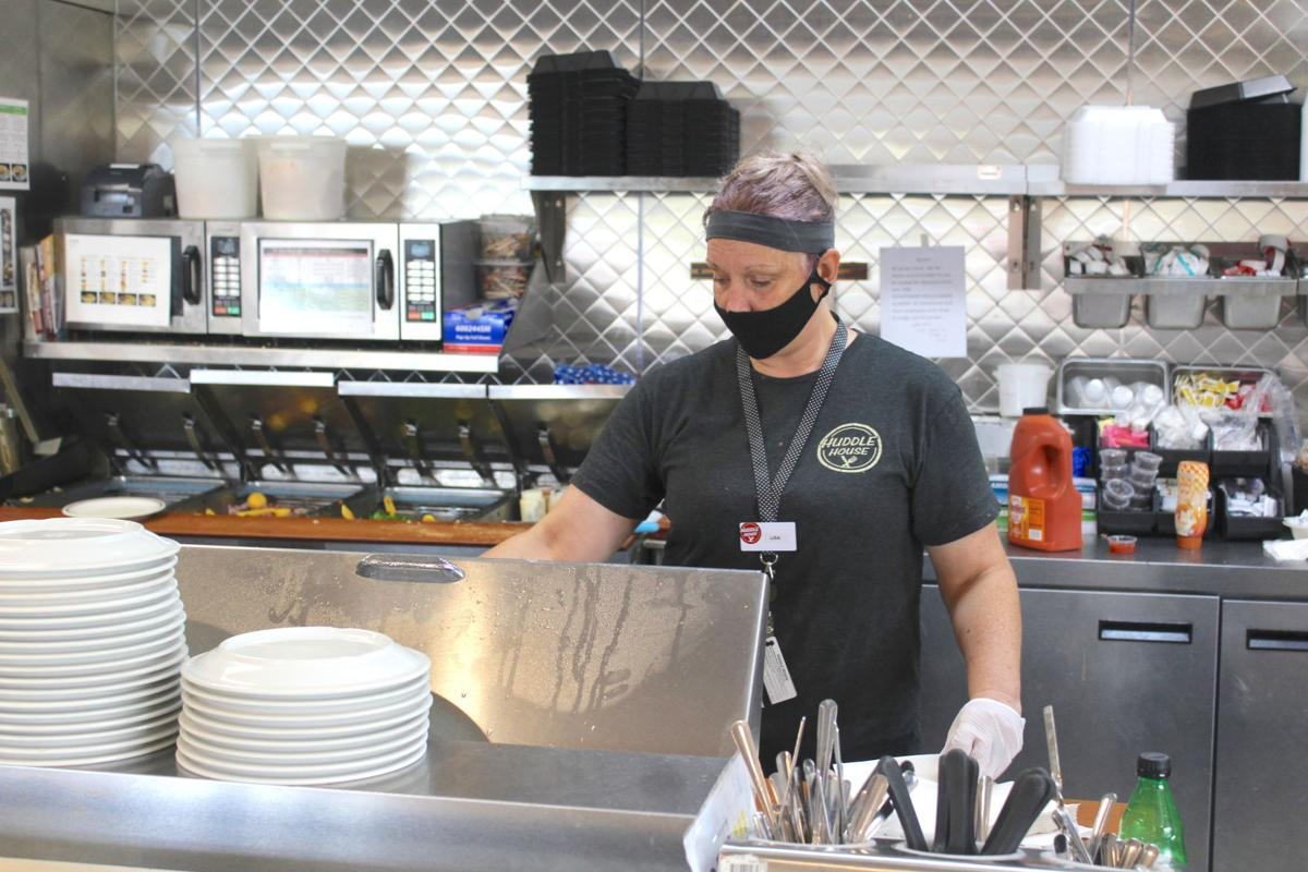 Pictured is Lisa, who works at Huddle House on Airport Road in Fort Payne. Employees have work masks and gloves since the dining room reopened per state guidelines.