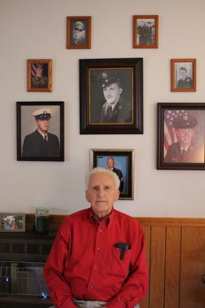 """<p class=""""p1"""">Junior B. Reese served in the Korean conflict and now displays pictures of all five generations of veterans in his family on his wall.</p>"""